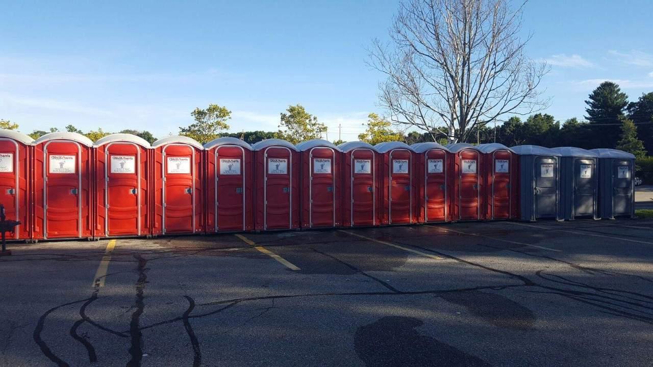 portable restroom in parking lot